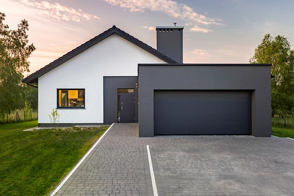 Monochromatic garage design with black door.