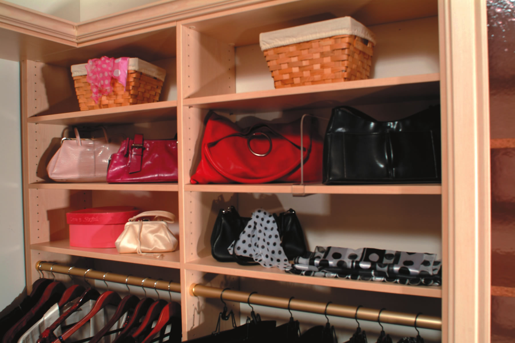 Custom built cubbies with handbags neatly placed