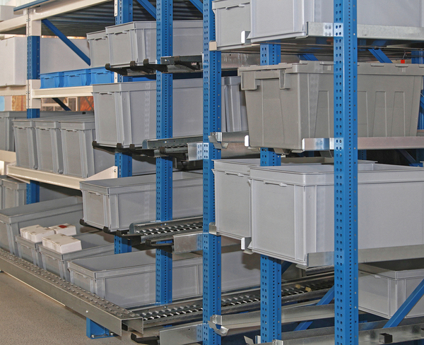 Plastic storage bins on shelves