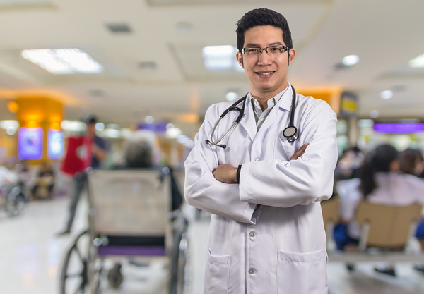 Medical doctor with a stethoscope around his neck.