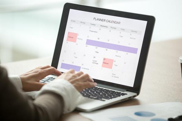 Planner calendar displayed on laptop.