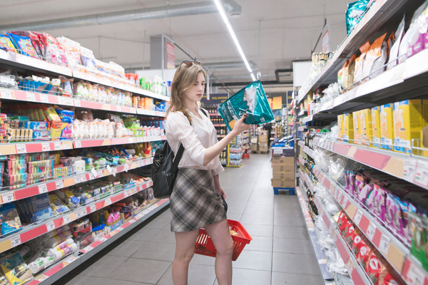 Woman looking at package in a store.