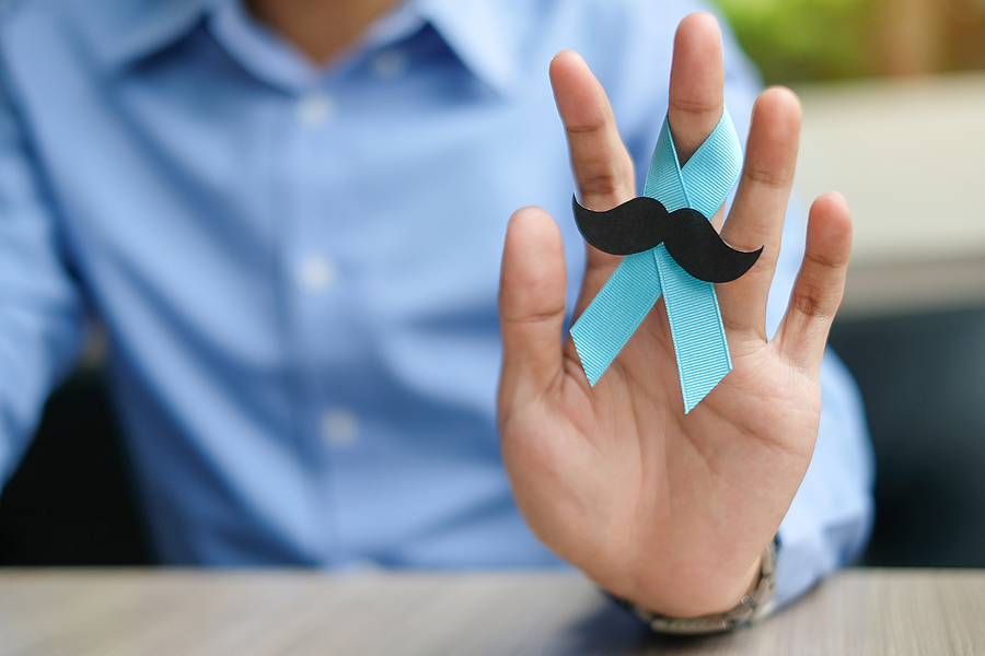 Hand with a blue ribbon.