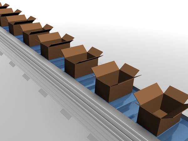 Cardboard boxes on a conveyor belt.