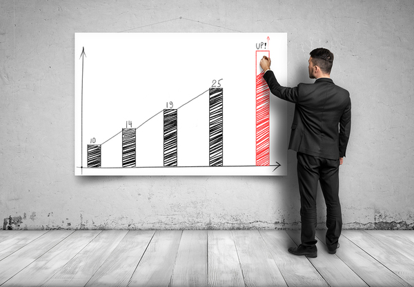 Man in Front of Return on Investment Graph for Video Marketing Campaigns