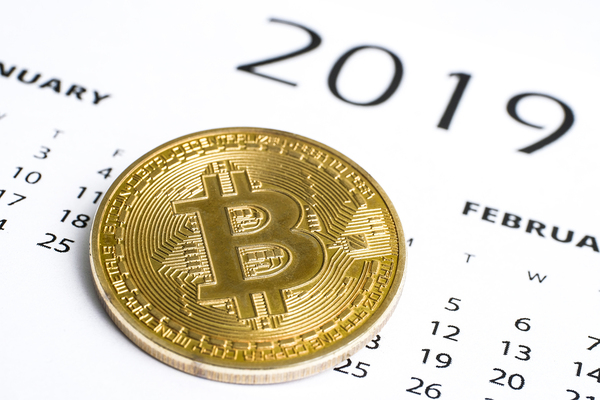 Gold coin with bitcoin symbol and 2019 calendar.