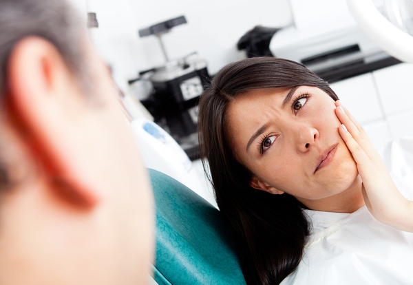 Regular dental checkups are necessary for catching symptomless problems.