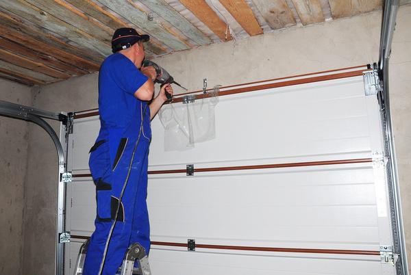 Man installing a garage door.