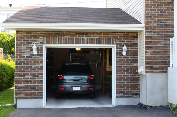 Single car garage with car parked inside.