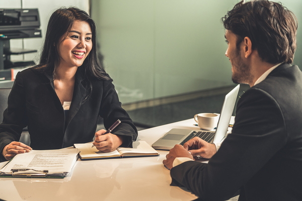 Hiring manager interviewing a potential candidate.