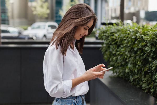 Woman typing on her phone.
