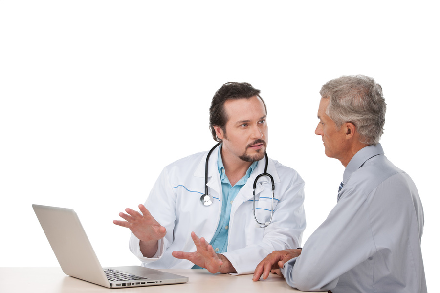 Doctor having a discussion with a male patient.
