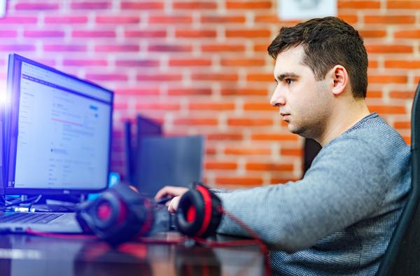 Typing on a desktop computer keyboard.