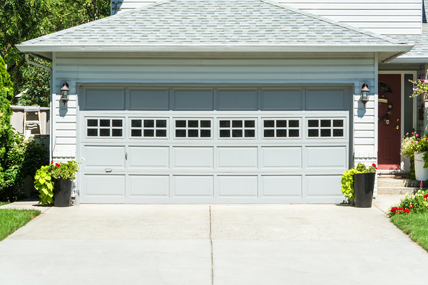 Double car garage with grey door.