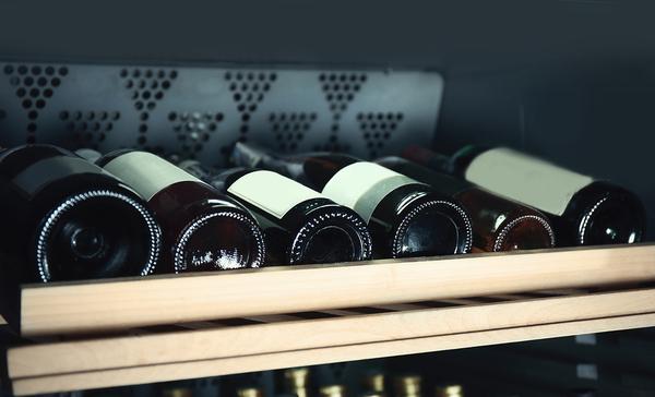 Shelf with wine bottles.