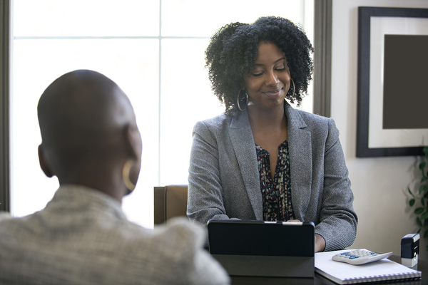 Woman interviewing a potential employee candidate.