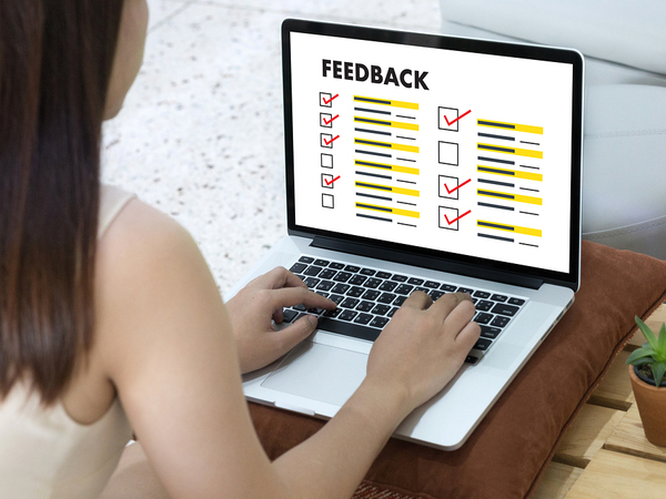 Woman leaving feedback using her laptop.
