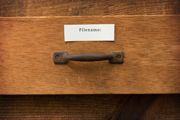 Wooden drawer labeled Filename: