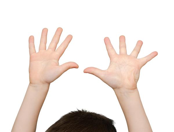 Person raising their hands above their head.