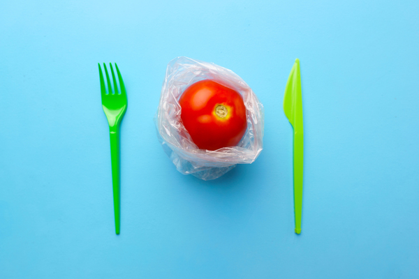 Tomato with fork and knife.