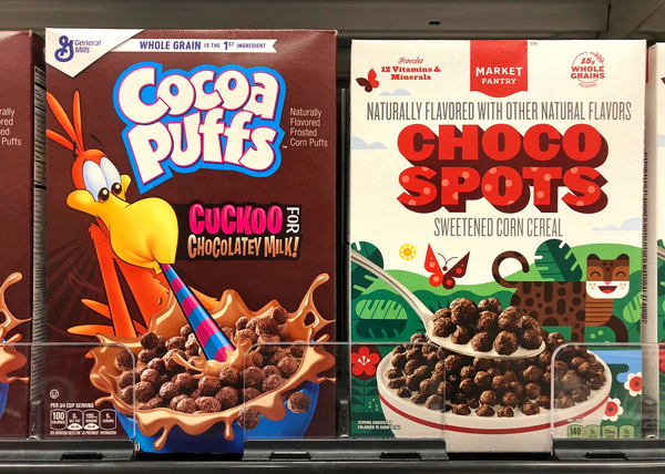 Box of Cocoa Puffs and choco spots.