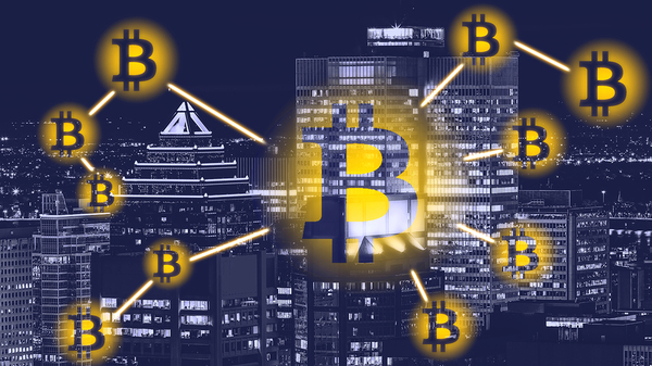 Bitcoin symbols in front of a city landscape.