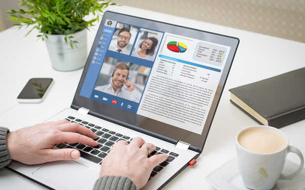 Virtual meeting using a laptop.