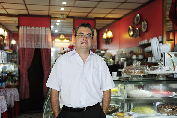 male business owner smiling in his shop