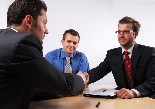 Job candidate shaking hands with an interviewer.