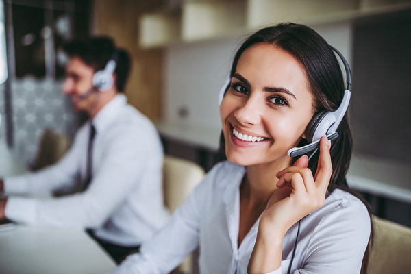 Woman with headset smiling.