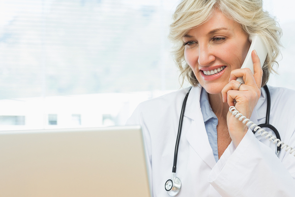Locum tenens doctor on the phone with staffing agency