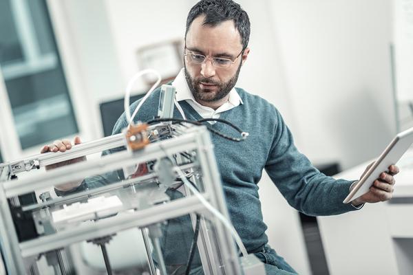 Technician working on hardware.