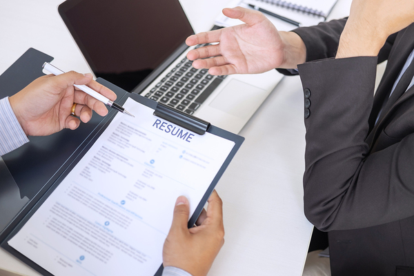 Hiring manager reading an job candidates resume.