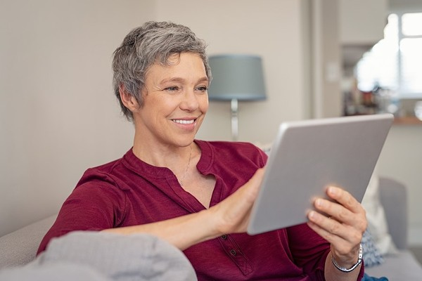 Smiling woman looking at her tablet