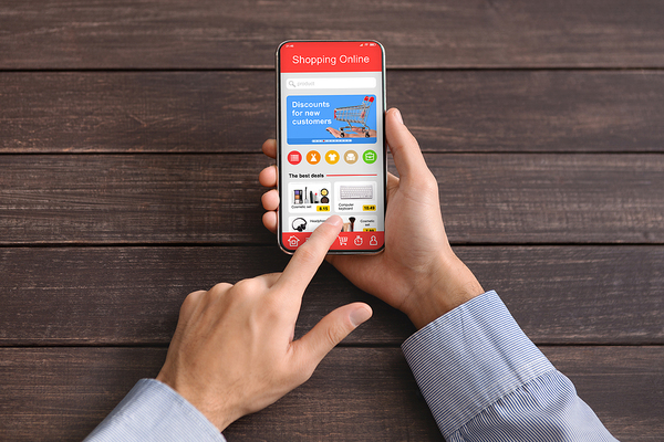 Shopping online using a phone.
