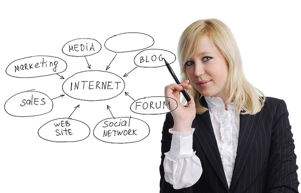 Woman pointing to a internet diagram.