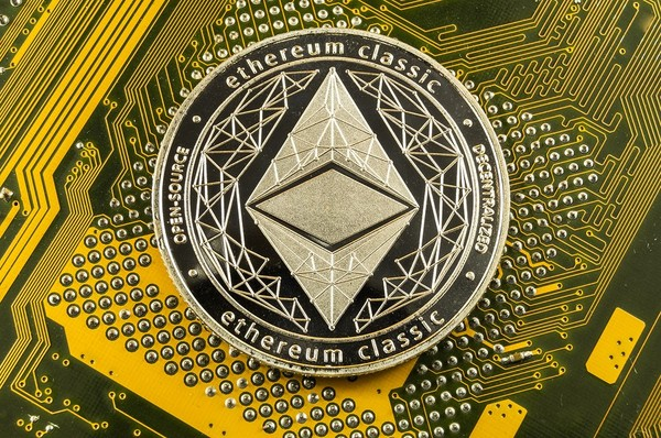 Gold coin with ethereum classic labeling.