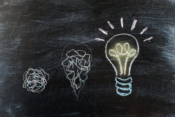 Lightbulbs drawn on a chalkboard.