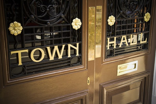 Wooden entry doors labeled Town Hall.
