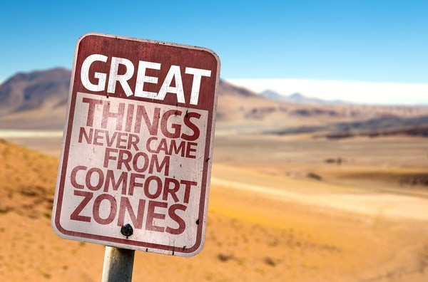 Street sign labeled Great things never came from comfort zones.