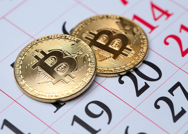 Gold coins with bitcoin symbols.