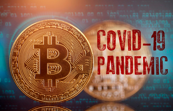 COVID-19 Pandemic gold coin with bitcoin symbol.