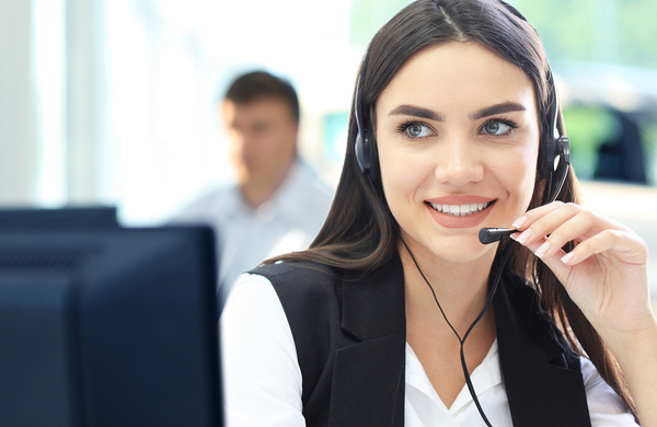 Woman smiling with a headset on.