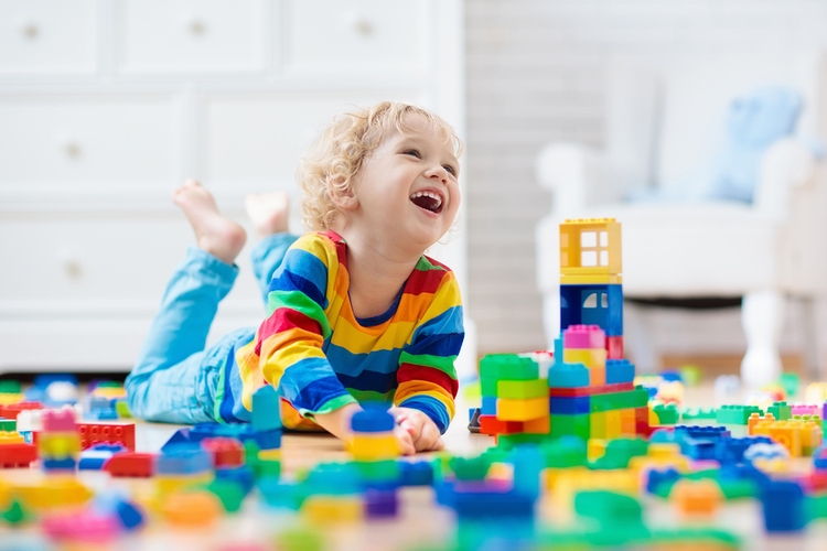 Child playing with plastic blocks.