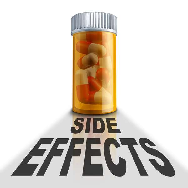 Bottle of pills with the words side effects written below.