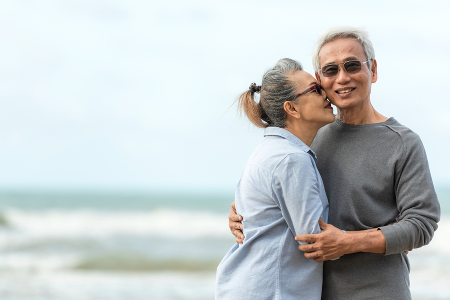 Happy couple hugging on a beach.