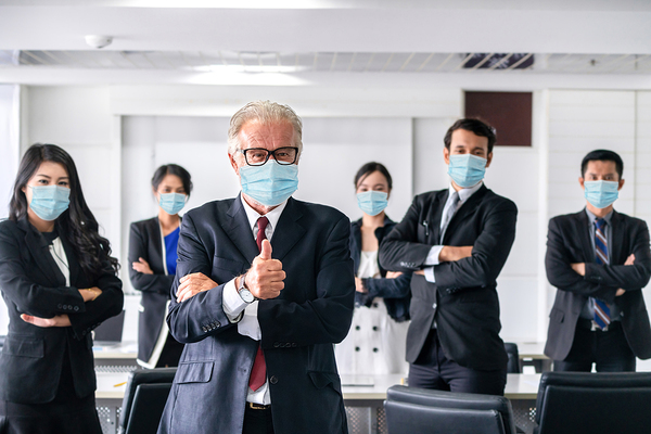 Group of colleagues wearing personal protection masks.