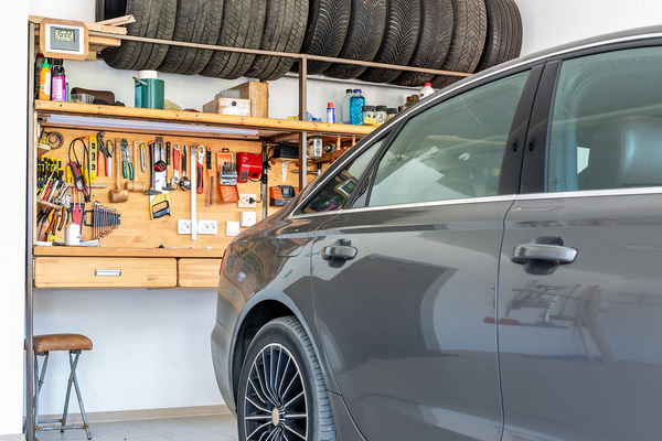 Garage with car and organized tools.