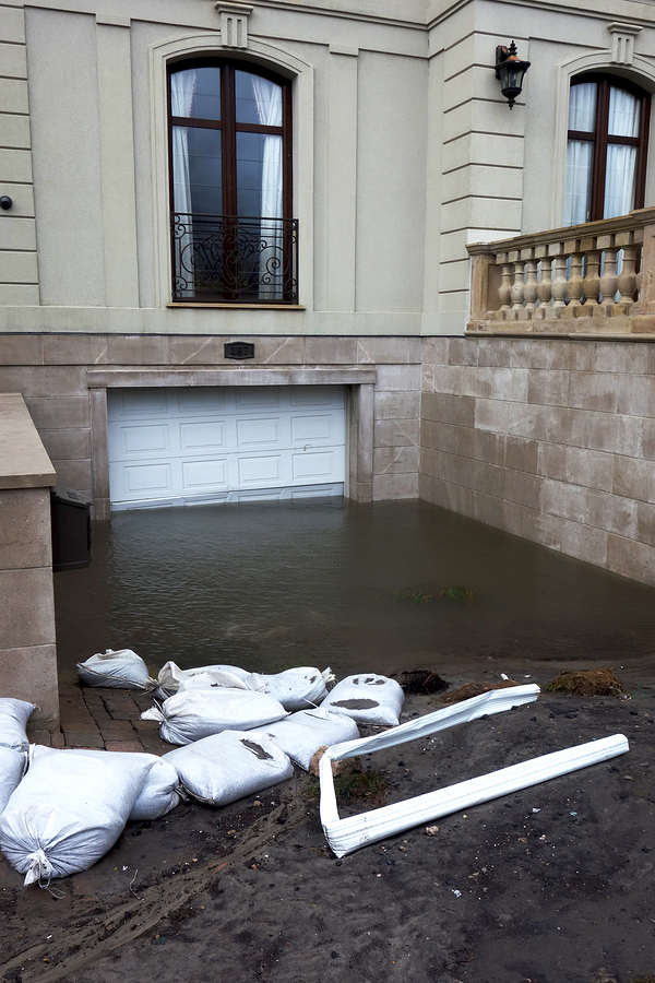 Sandbags at the entry of a garage area.