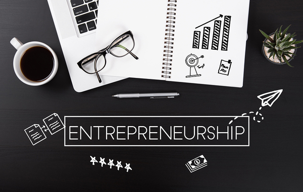work desk with illustrations and the word entrepreneurship